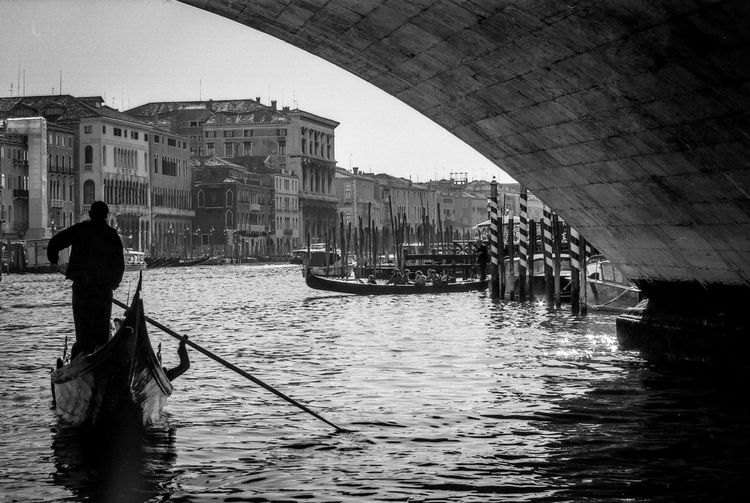 Canal Grande view with gondola in Venice Architecture Black And White Photography Built Structure Day Film Photography Gondola - Traditional Boat Gondolier Mode Of Transportation Real People Rear View Rowing Standing Transportation Vintage Photo Water Waterfront