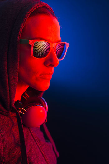 Close-up portrait of sunglasses against black background