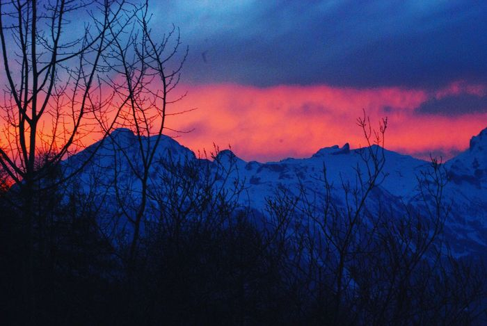 Mountain Sunset Mountain View EyeEm Selects Sunset Tree Dramatic Sky Beauty In Nature Sky Outdoors Scenics Nature No People Silhouette Mountain Landscape Cloud - Sky EyeEm Ready   Shades Of Winter