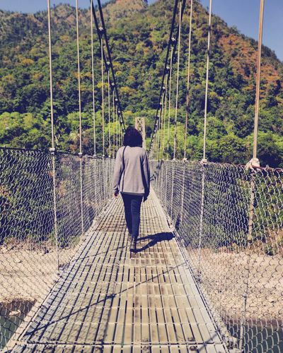 """""""Discipline is the bridge between goals and accomplishments."""" #nepal #dharan Cheapthrills Shadows & Lights Peaceful View Autumn Nature #bridge #bridgewalk Real People Full Length Day Lifestyles Outdoors Casual Clothing Leisure Activity"""