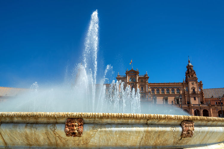 Details of the fountain in the Plaza de Espana in historic Seville, Spain Sevilla Seville SPAIN Travel Destinations Travel Tourism Architecture Built Structure No People Europe Historic Andalucía Andalusia Fountain Water Plaza De España Clear Sky Blue Sky Building Exterior Spraying Motion Splashing