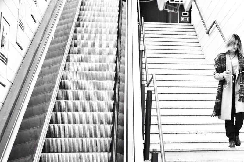 Biancoenero Scala Donna Moving Walkway  Consumerism Modern Direction Technology Low Angle View Women Escalator Adult People Lifestyles Moving Up Indoors  Rear View Real People Transportation Steps And Staircases Staircase Railing Architecture International Women's Day 2019 17.62° Streetwise Photography The Street Photographer - 2019 EyeEm Awards