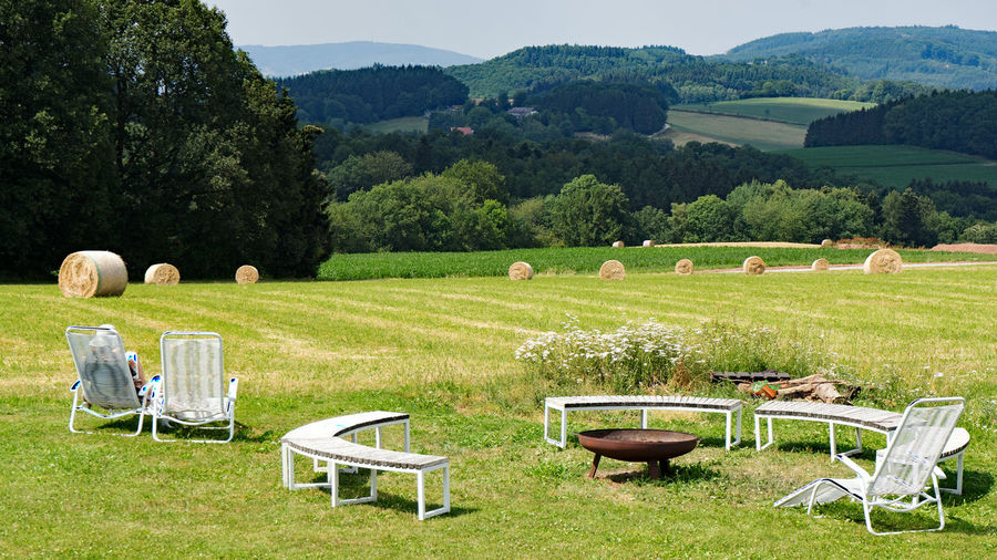 Agriculture Beauty In Nature Chair Day Environment Field Grass Green Color Land Landscape Nature No People Outdoors Plant Rural Scene Scenics - Nature Seat Sky Tranquil Scene Tranquility Tree Waldmichelbach