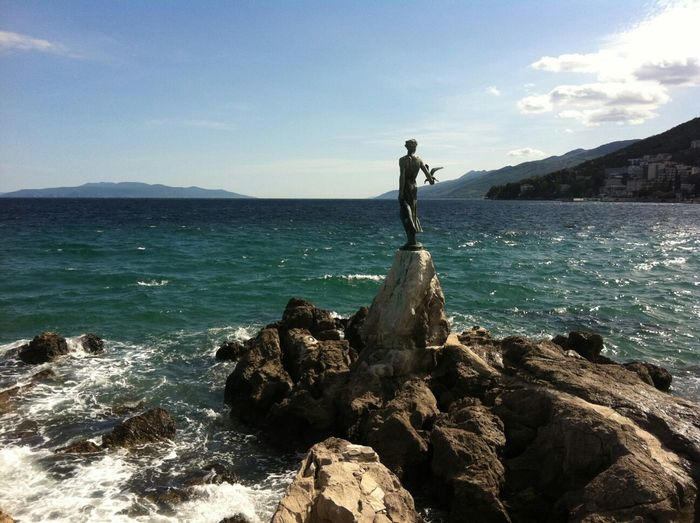 View of statue against calm sea
