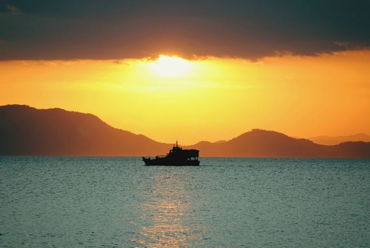 Boat Relaxing Peaceful Drilling Rig Offshore Platform Water Mountain Sea Sunset Nautical Vessel Silhouette Mountain Range Tranquility Scenics Non-urban Scene Idyllic Calm Tranquil Scene