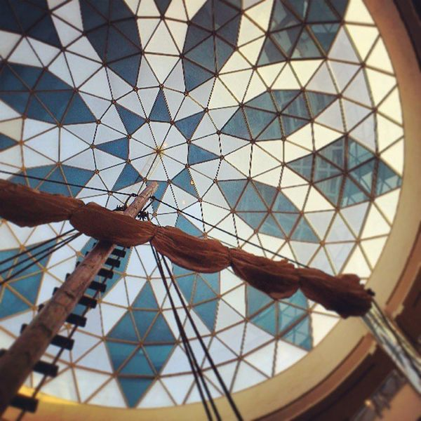 Sitting and enjoying Coffee break after Shopping . at the Wooden Ship in the middle of the small lake at rashed mall rashed_mall. Looking at the sail and the glass dome. medina madina madinah saudi_arabia saudiarabia ksa. Taken by my sony xperia arc. سفينة شراع الراشد مول الراشد_مول المدينة_المنورة المدينة تسوق السعودية