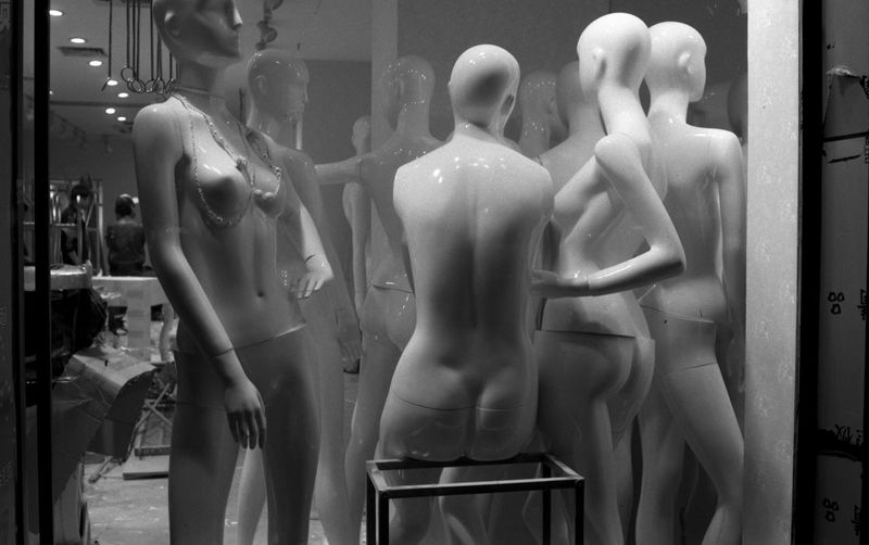 View of mannequin in front of wall