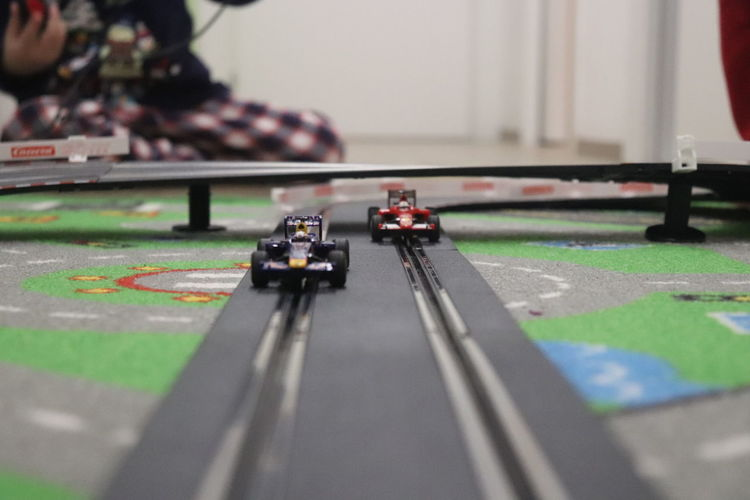 Close-Up Of Toy Cars On Track