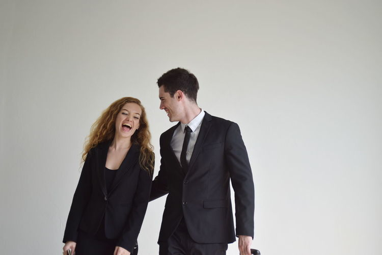 Two People Standing Young Men Front View Young Adult Togetherness Studio Shot Indoors  Young Women Women Couple - Relationship Adult Copy Space People Suit Well-dressed Looking Bonding Emotion Hairstyle