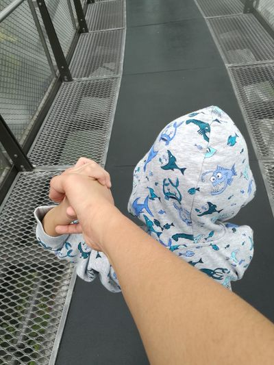 Close-up of hand holding a child hand