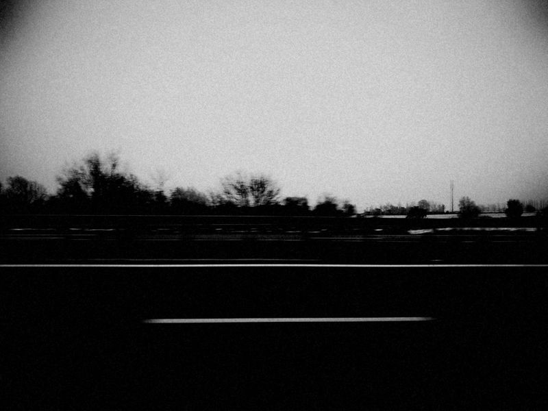 On the road again Road Asphalt Outdoors No People Black And WhiteTransportation Huawei P9 Photography Black & White Huawei Leica MonochromeBlackandwhite Photography Cloud - Sky Huawei P9 Leica Tree Day Sky Clear Sky Nature Highway Highwayscape