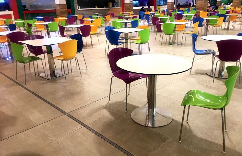 Vibrance Chair Table Empty In A Row Seat Group Of Objects Cafe Education Indoors  No People Day Colors Vibrant Alive  Indoor Foodcourt Empty Chair