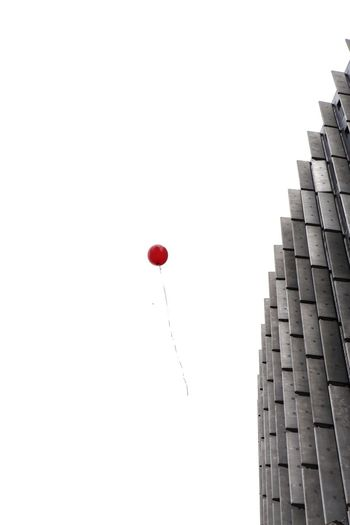 Mid-air Red Low Angle View White Background Balloon No People Outdoors Day Red Balloon Architecture Minimalism Minimalist Architecture Red Color Sky Clear Sky Berlin Discover Berlin Colour Your Horizn Go Higher
