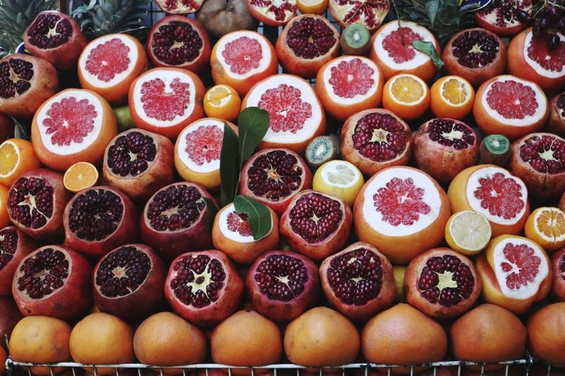 Food And Drink Food Freshness Healthy Eating Large Group Of Objects Fruit Wellbeing For Sale Market Orange Color Abundance Arrangement High Angle View Cross Section Choice No People Full Frame Still Life Variation Citrus Fruit
