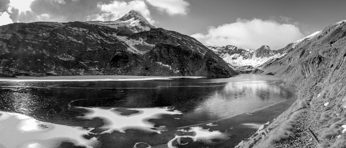 BW. Panoramica del Lago d'Aviasco. BW. Overview of Lago d'Aviasco. Mountain Scenics - Nature Cold Temperature Mountain Range Sky Beauty In Nature Nature Cloud - Sky Day No People Snowcapped Mountain Tranquil Scene Water Outdoors Mountain Peak Beauty In Nature Blue Landscape Lake EyeEm Best Shots EyeEmNewHere EyeEm Nature Lover EyeEm Selects EyeEm Gallery Blackandwhite