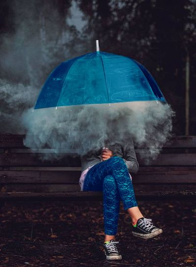 A girl sitting in the garden in a rainy atmosphere Cigarettes Love Nature The Garden Winter Blue Day Girl Misleading One Person First Eyeem Photo