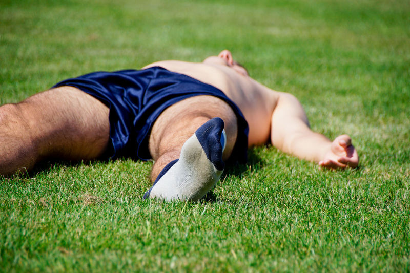 Shirtless Soccer Player Sleeping On Field