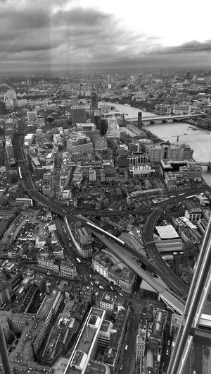 London skyline Photowalktheworld EyeEm Selects The Architect - 2018 EyeEm Awards Blackandwhite Storms Coming Black And White Cloudy Day City Cityscape Urban Skyline Skyscraper Aerial View High Angle View Sky Architecture Building Exterior Built Structure Elevated Road Ferris Wheel Urban Sprawl Office Building