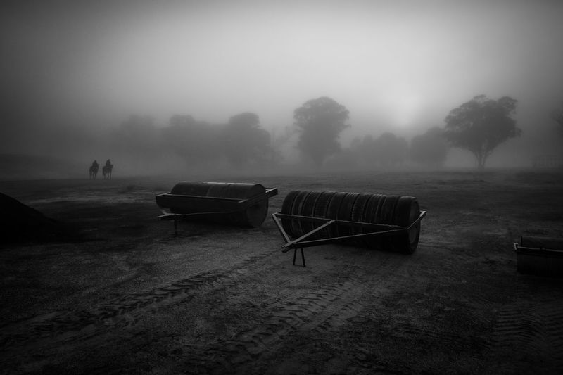 Agricultural Machinery In Farm Against Sky During Foggy Weather