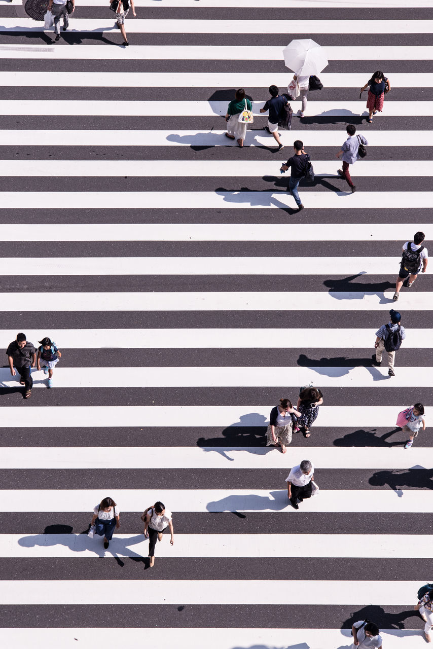 High Angle View Of People Crossing On Road