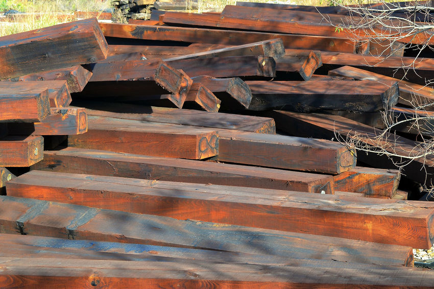 Brown Wooden Railway Sleepers Wooden Railway Sleepers Railway Sleepers Wooden Beam Wooden Beams Wood - Material Stack No People Day Large Group Of Objects Outdoors Sunlight Industry Heap