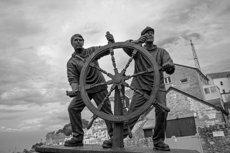 Man and Boy based on an etching by Arthur Briscoe Brixham  Devon Fishing Village Man The Wheel Wheel Arthur Briscoe Boy Brixhamharbour Fishing Low Angle View Man And Boy Monochrome Outdoors Sculpture Tourism Tourism Destination