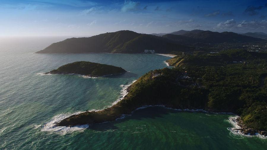 Aerial view of seashore against sky