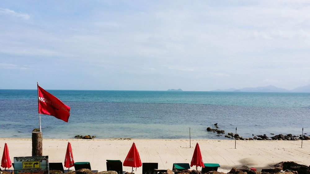 #sea#sky#sail#sunset#boat #sea #summer #travelphotography #travel #Relaxing #Nature  #journey #Thailand #samui #photography #sky #sand Politics And Government Water Sea Military Beach Patriotism Red Flag Sand Sky Beach Umbrella