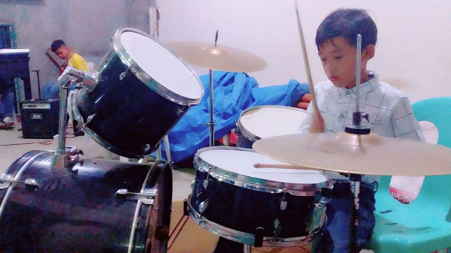 A young drummer
