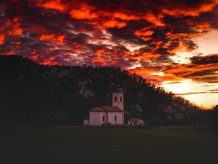 I'm in awe. Saint Daniel's church, Slovenia. The surrounding lake is gone, sadly. Nature Photography Slovenia Scapes Slovenia EyeEm Selects Sunset_collection Sunset Silhouettes Sunsetporn Sunset And Clouds  Countryside Country Landscape_Collection Landscape Autumn colors Vipava Valley Sunset_captures Country Life Natural Natural Phenomenon Church Architecture Sunset Tree Autumn Sky Architecture Building Exterior Built Structure Cross Christianity Church