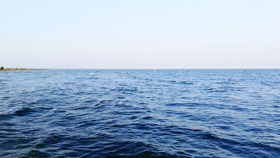 Wind surfing, calm blue water, clear sky Horizon Over Water Water Seascape Blue Outdoors Water Surface Calm Sea