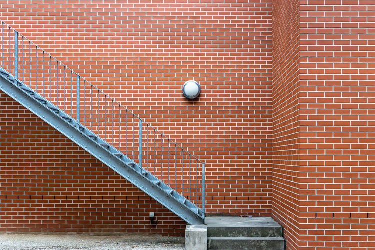View of red brick wall with staircase