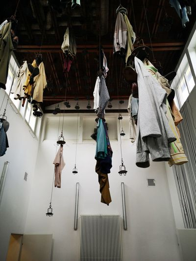 Low angle view of clothes drying on ceiling
