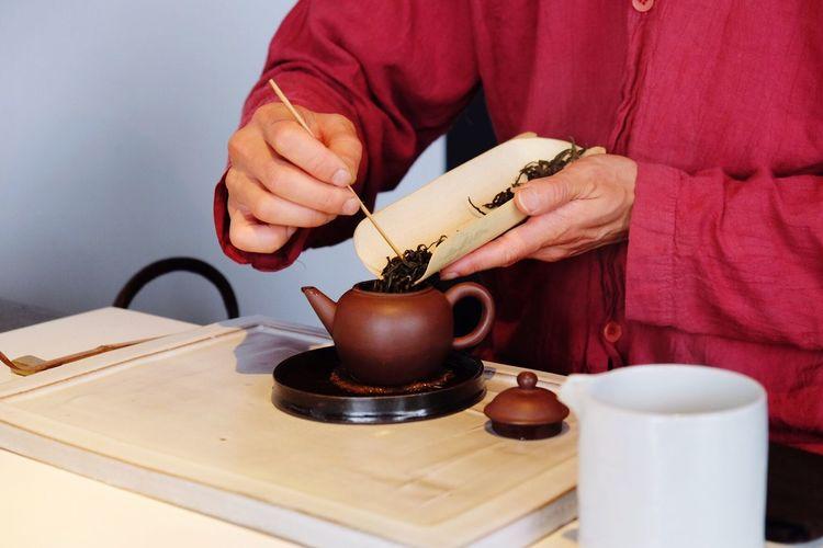Person preparing tea