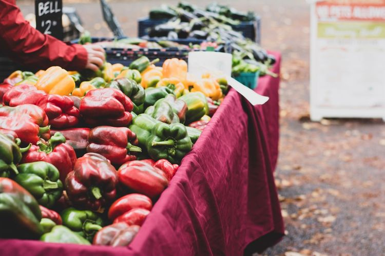 Food And Drink Food Vegetable Healthy Eating Choice Market Retail  Freshness Wellbeing Variation For Sale Market Stall Large Group Of Objects Pepper Abundance One Person Red Business Day Incidental People Organic Retail Display Sale Buying Consumerism