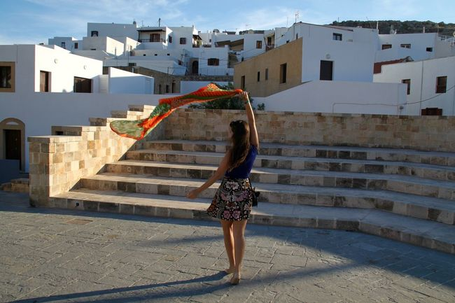 Lindos Architecture Architecture Building Exterior Built Structure City Dancing Enjoying Life Full Length Greece Leisure Activity Lifestyles Lindos One Person Rhodes Ródos Town Whitewashed Wind Women Young Women City Architecture Standing Fashion Residential District
