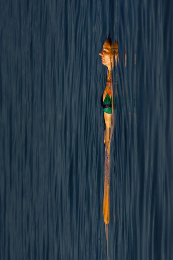 Mature woman floating on sea