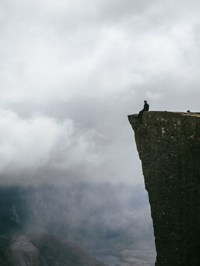 Adult Beauty In Nature Climbing Cloud - Sky Day Fog Full Length Landscape Mountain Nature Norway One Animal One Man Only One Person Outdoors People Perching Preikestolen Pulpit Rock Climbing Scandinavia Scary Sky Young Adult