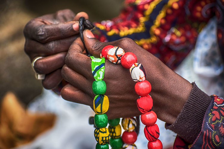 Hands at work Close-up Colorful Colours Cultures Day Emigration Ethnic Focus On Foreground Group Of Objects Hand Hands Immigrant Immigration Job Market Stall Multi Colored Necklace No People Retail  Selective Focus Still Life Variation