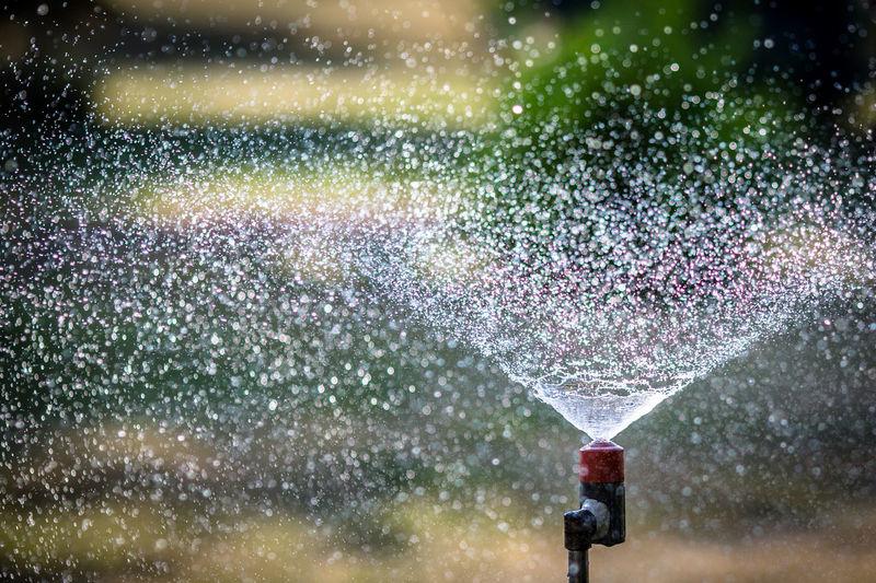 Close-Up Of Sprinkler Against Blurred Background