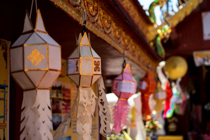Hanging Decoration Lighting Equipment No People Religion Focus On Foreground Place Of Worship Belief Spirituality Built Structure Lantern Art And Craft Architecture Close-up Building Day Selective Focus Craft Outdoors Paper Lantern