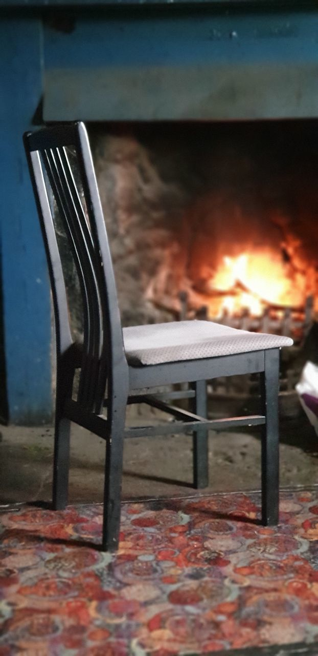 EMPTY CHAIRS AGAINST FIRE AT HOME
