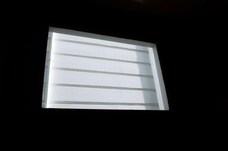 Close-up of window in darkroom