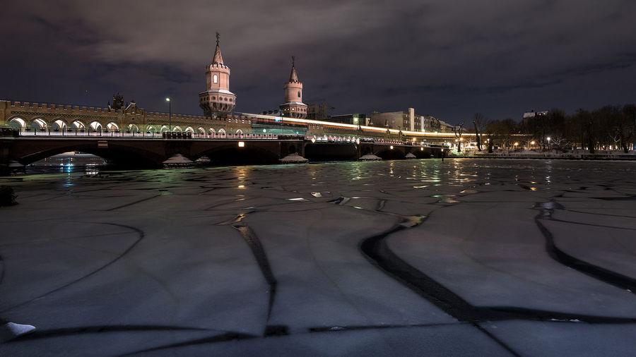 Oberbaum Bridge Over Frozen River Against Sky