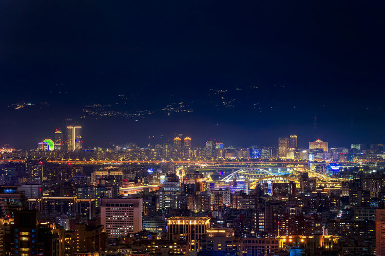 High angle view of illuminated city against sky at night  taiwan.