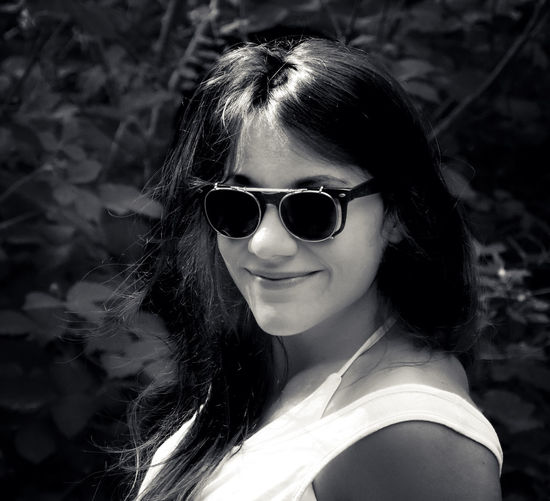 Beautiful Woman Beauty Fashion Focus On Foreground Glasses Hair Hairstyle Headshot Leisure Activity Lifestyles Long Hair Looking At Camera One Person Outdoors Portrait Real People Smiling Sunglasses Women Young Adult Young Women