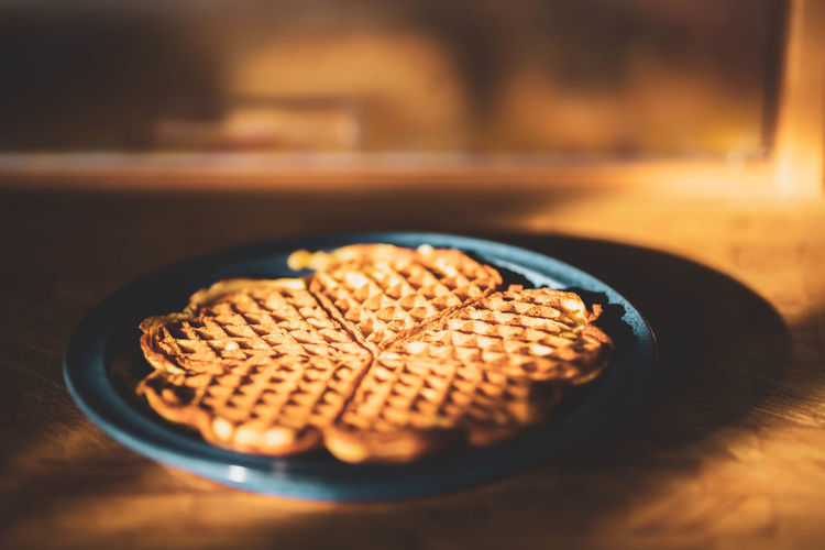 high angle view of waffles in plate on table Brown Close-up Dezember Food Food And Drink Freshness Healthy Eating High Angle View Indoors  Indulgence Nature No People Plate Ready-to-eat Selective Focus Snack Still Life Sweet Food Table Temptation Waffel Wellbeing Wood - Material