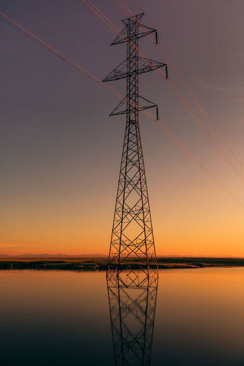 Power line Alberta,Canada Beauty In Nature Cable Connection Electricity  Electricity Pylon Fuel And Power Generation Nature No People Outdoors Scenics Silhouette Sky Sunset Symmetry Technology Tranquility Water