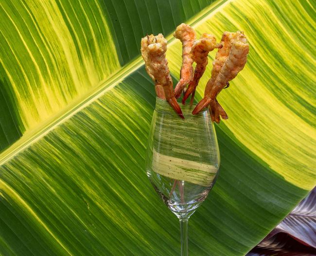 Close-up of banana leaf on glass
