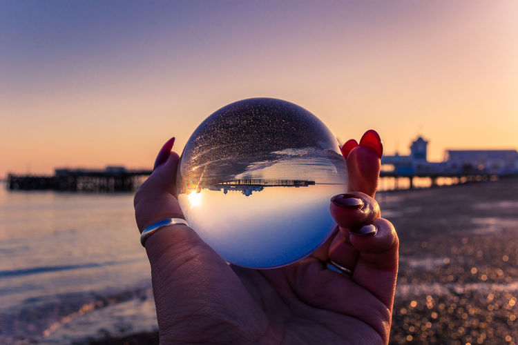 Portsmouth Architecture Body Part Building Exterior Built Structure City Cityscape Close-up Crystal Ball Finger Focus On Foreground Hand Holding Human Body Part Human Hand Nature One Person Outdoors Personal Perspective Reflection Sky Southsea Sphere Sunlight Sunset